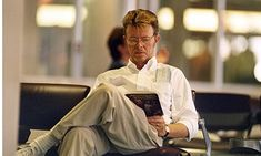 David Bowie reading about Francis Bacon in 1995. Photograph: REX/Action Press. | Suzanne Moore: From Yukio Mishima to George Orwell, Angela Carter, James Baldwin and Viz, the rock icon's top-100 book list has actually managed to make me love him even more.
