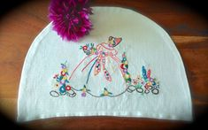 Check out this item in my Etsy shop https://www.etsy.com/uk/listing/476451949/hand-embroidered-crinoline-lady-vintage