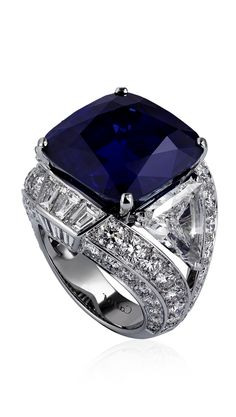 BLEU-BLEUET RING Platinum, one cushion-cut sapphire (29.06 carats) from Kashmir, triangular-shaped diamonds (2.43 carats and 2.17 carats), calibré-cut diamonds, brilliant-cut diamonds.