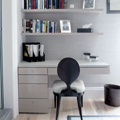 A clean, modern desk space! The floating shelves really add space and radness to this office area! Love it!