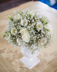 Flowers enhance any home or business, gypsophila, ivory roses and lizianthus.