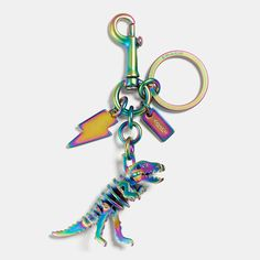 Add some attitude to your favorite Coach bag (and keys) with a fluorescent bag charm featuring our new dinosaur mascot, Rexy, hanging with a glam-rock lightning bolt and a diminutive Coach hangtag charm.