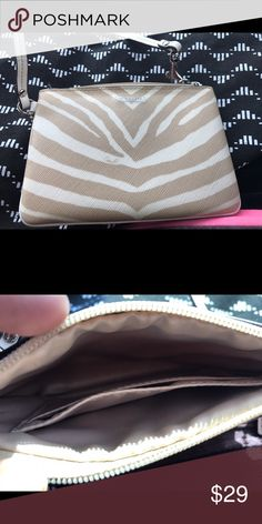 Zebra Print Coach Wristlet! Authentic COACH SM Wristlet. Like new condition! Only used a couple of times. No noticeable flaws. Coach Bags Clutches & Wristlets