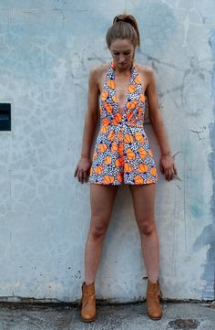 FOR THE BRAVE PLAYSUIT The boldest print and the sauciest cut. Super sexy and quirky all in the one package. Unique little number. HEY LADIES - we only have one orange print left in an 8, but it's available in the same print with a bright yellow. it's every bit as adorable.