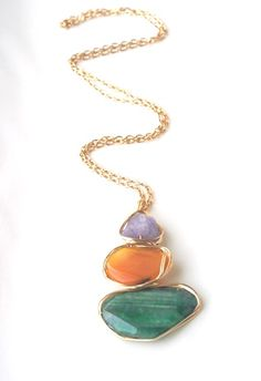 JESSICA – MULTI -  A textural three stone statement necklace consists of purple amethyst, orange agate and green jade stacked together with gold aluminum wire, forming one pendant.  http://www.cayetanolegacy.com