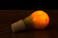 PP Pear light bulb, Photographer Makes Fruits and Vegetables Glow by Sticking Lights Inside