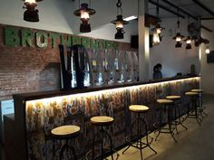 Rustic industrial bar table design | brotherhops beer corner Solo-Indonesia | vintage bar stool, reclaimed wood front table, recycled oils drum letters logo, rustic industrial bar lamps | design by wawan louis upcycle201 concept, solo-indonesia, kopihitamku201@gmail.com