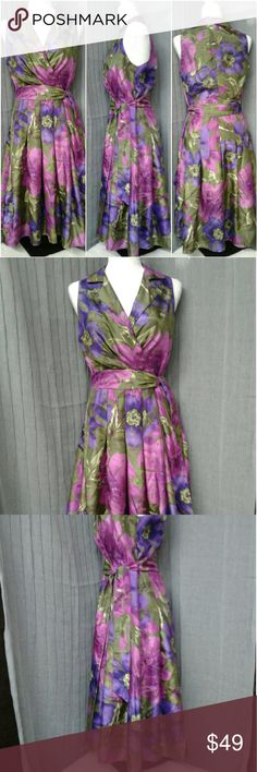 Jessica Howard dress size 10 Classy dress sleeveless by Jessica Howard size 10 beautiful colors of purple pink and greens made in Sri Lanka materials are dress 100% polyester lining is also one hundred percent polyester exclusive of decoration comes with a belt zips on the side measurements laying flat armpit to armpit is 19 inches length from top of shoulder down is 43 inches Jessica Howard Dresses