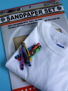 Kids did this in Kindergarten...they LOVED it! Draw on sandpaper with crayon, turn upside down, iron onto T-shirt. how proud will kids be to wear their original art designs! This would be a fun idea for a birthday party