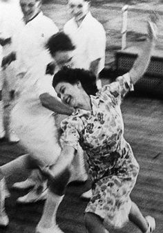 Queen Elizabeth II (then Princess Elizabeth) playing tag with midshipmen on board HMS Vanguard during the Royal Tour of South Africa,