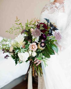 A Celestial-Inspired, Fall Wedding in Minnesota | Martha Stewart Weddings - Britt's richly colored bouquet (made by Munster Rose) held white mink protea—native to Courtney's home country of Australia—and locally grown dahlias. It was a perfect accent to her Monique Lhuillier gown, which featured embroidered tulle sleeves and multiple types of lace adorned with subtle ivory beading.