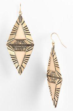 I love unique earrings...