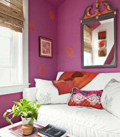 "While Teague loves dramatic color, she also realizes it can overwhelm the senses. ""I could never sleep in a hot-pink room,"" she admits. ""But this home office is a space I rarely use."" Inspired by flowers in her yard, the designer covered the walls in her line's attention-grabbing Peony, then painted on a few bright-orange leaves. A white Ikea sofa and foliage-print pillows sewn from Kravet fabric provide cool balance in the home office. The multihued pillow is from Anthropologie; the…"