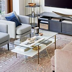 Our two-tiered Art Display Coffee Table doubles down on mid-century style and storage space with its clean lines and durable, airy glass top. Reclaimed Wood Coffee Table, Walnut Coffee Table, Modern Coffee Tables, Furniture Decor, Modern Furniture, Luxury Furniture, Mid Century Art, Room Planning, Bedding Shop