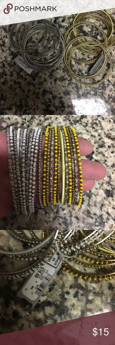 NWT Avenue Two Sets of 11 Bangles Yellow and White NWT Avenue Two Sets of 11 Bangles Yellow and White Never Worn Retailed for $15 each Avenue Jewelry Bracelets