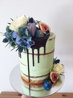 Mint green naked cake with dark chocolate drip, hydrangeas, blue seaholly, macarons & figs #haranspatisserie #dessertistheanswer