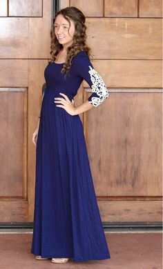 A navy 3/4 sleeve maxi dress with modest high neckline and crochet detailed sleeves.