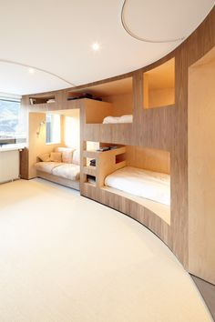 bedroom: end point - fully built in beds and storage with neat integrated seating area.