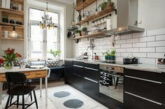 Image from http://cdn.decoist.com/wp-content/uploads/2015/07/Small-and-stylish-Scandinavian-kitchen-with-breakfast-nook-and-floating-wooden-shelves.jpg.