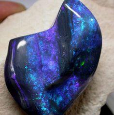 250 carat Black Opal.