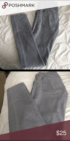 Men's light grey skinny jeans Good condition, the color is a little lighter than photo two. But my camera wouldn't capture the color just right. Divided Jeans Skinny