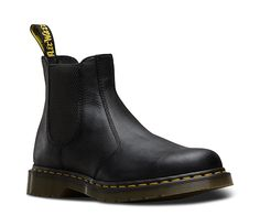 The 2976 Chelsea boot has been refreshed this season with soft, tumbled Carpathian leather—our premium, full-grain leather with a natural tumbled texture. This versatile Chelsea boot is ankle-high, pulls-on and is a fashionable and practical unisex style. Elastic gussets give this Chelsea boot a secure fit with easy on-and-off wear. Goodyear welting, side stitch and tonal heel loop, this style is a refined progression from the Dr. Martens trademark DNA. The bouncy AirWair sole is…