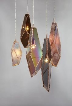 These beautiful geode light sculptures would look perfect over a dining table. This lighting idea is a statement piece yet simply beautiful.