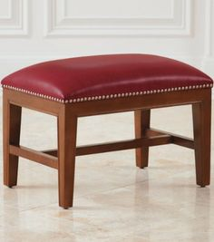 The architectural wood frame of our Harriet Leather Ottoman creates the perfect counterpoint to its smooth and colorful cushioning.