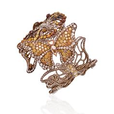 Butterfly Cuff featuring 6.50 carats of Fancy Yellow Round Brilliants; 15.78 carats of Fancy Yellow Rose Cuts; 8.16 carats of Round Brilliant Collection VS diamonds; Titanium setting. Lugano Diamonds