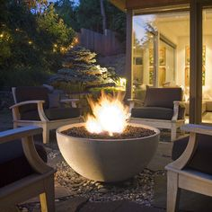 """The Solus 36"""" Hemi Firebowl stands at 16.5"""" tall, 36"""" across and available as natural gas (75,000 BTUs) or liquid propane (80,000 BTUs). It is the perfect way to add spark to more intimate outdoor spaces. Handcrafted in smooth high-performance concrete, this serene outdoor fire pit cradles its flame in a beautifully sculptural concavity."""