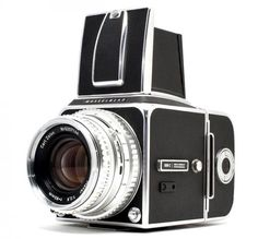 Hasselblad 500 C. One of these with a digital back is sweet.