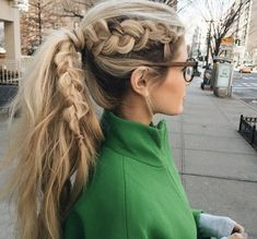 Dutch braid into a ponytail by Amber Fillerup Clark