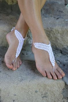 Beach wedding shoes, White Crochet Barefoot Sandals, Foot jewelry Bridal Sexy Yoga, Bridesmaid gift idea. Beach wedding White Crochet. Ideal variant for beach, pool, yoga or home. They are great for beach parties and weddings. Nice holiday gift for female who loves beach. Also it will be a wonderful bridesmaid gift.     100% cotton Color: white Hand wash or machine wash. Dry naturally. Please do