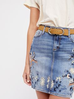 Kate Skirt | Classic fit, stretch denim skirt featuring beautiful nature-inspired embroidery throughout.  * Zipper and button closure * Five-pocket design * Back vent