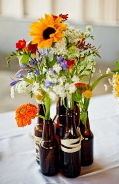 beer bottle vases - for DIY bbq wedding center pieces. wrap with twine or jute.:, beer bottle vases - for DIY bbq wedding center pieces. wrap with twine or jute. Fall Wedding, Diy Wedding, Wedding Flowers, Wedding Ideas, Wedding Backyard, Wedding Simple, Trendy Wedding, Elegant Wedding, Simple Weddings