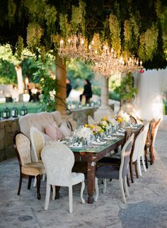 dinner party chandeliers......love the mix of vintage chairs