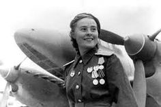WWII --- Soviet fighter pilot Lydia Litvyak and a Petlyakov She primarily flew a Yakovlev First female fighter ace in history, shooting down 12 German aircraft in 66 missions. She was shot down and killed at the Battle of Kursk in August (Photo - Russia Female Fighter, Fighter Pilot, Amelia Earhart, Women In Combat, Female Pilot, Military Female, Female Soldier, Military Women, Aviators Women