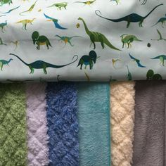 Custom Dinosaur WholeCloth Baby Quilt by SmallBatchBoutique