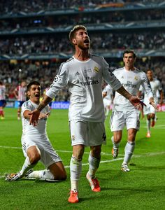 Sergio Ramos of Real Madrid celebrates scoring their first goal in stoppage time during the UEFA Champions League Final between Real Madrid ...
