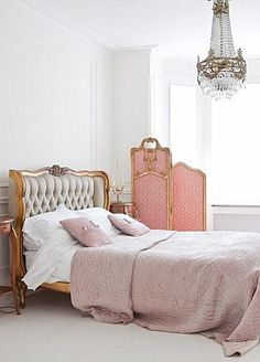 lovely headboard, chandelier , & pink screen