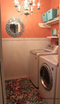 I do love this laundry room! I'm thinking a large rug would be good under the washer/dryer. Keeps the dirt & dust from flying underneath & building up too much.