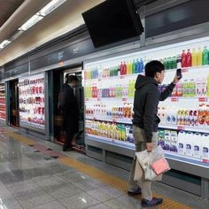 "Virtual supermarkets are popping up in subway stations in South Korea, where commuters can virtually shop for items while waiting for the train to come. Customers simply scan an item's QR code using the free ""Homeplus"" app and can have it delivered to their doorstep before they even get home. Ranked as the 2nd most hard-working country in the world to Japan, South Korea is rewarding its workers with this timesaving gem."