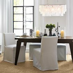 A cool linear or rectangular chandelier for over the slab dining table