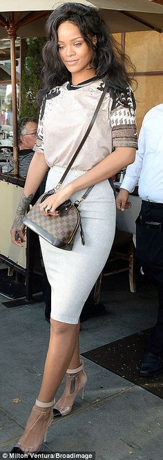 Bed hair, don't care: Rihanna was spotted arriving for lunch in a toned down pencil skirt and tee at Il Pastaio Ristorante in Beverly Hills on June 17, 2014 http://dailym.ai/UaLzuw