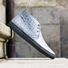 Axel Arigato grey ostrich embossed leather chukka sneaker with a back tab and three-eye lace closure. Inside, a calf leather lining and cushioned footbed deliver comfort to every wearing. #axelarigato