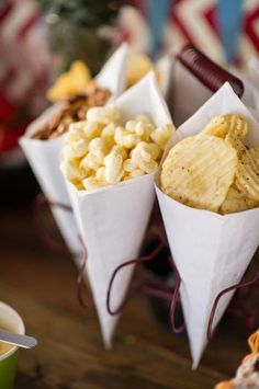 vintage railroad train party with popcorn, pretzels, and chips served in white paper cones