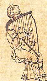 """""""Caedmon's Metrical Paraphrase of Scripture History,"""" c. 1025, shows Jubal of Genesis playing a harp. Approx 3' tall, right shoulder, held by knees. ms. Junius 11, folio 54. Bodleian Library, Oxford."""
