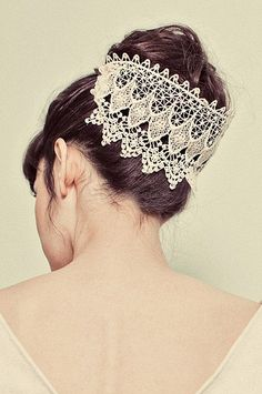 lace headpiece, in replacement for a veil. more casual for the reception.