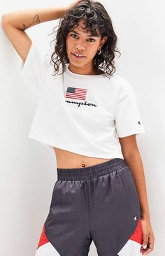 Head to your next adventure in the Logo Flag Cropped T-Shirt from Champion. This casual tee features short sleeves, crew neckline, embroidered logo at the chest with a flag patch, and a cropped fit. Champion Shirt, Champion Logo, Mens Swim Shorts, Gym Shorts Womens, Pop Fashion, Festival Fashion, Flag, T Shirt, Supreme T Shirt