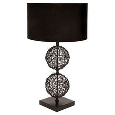 "Black table lamp with two rattan spheres.    Product: Table lamp  Construction Material: Premium grade metal alloy and natural wood  Color: Black  Accommodates: (1) 60 Watt medium base bulb - not included  Dimensions: 30"" H x 12"" Diameter"